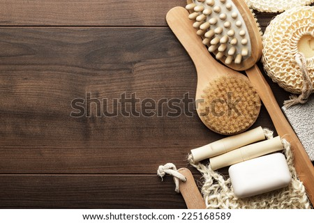 some bath accessories on the brown wooden background - stock photo