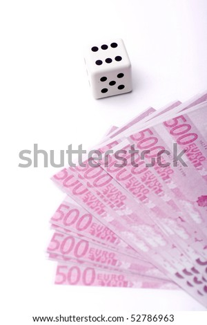 some bills won thanks to good luck playing dice - stock photo