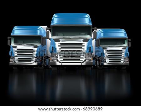 Some blue trucks isolated on black background - stock photo