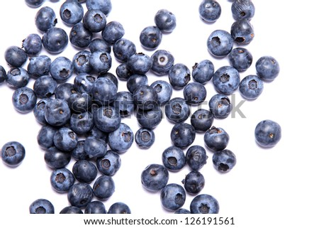 Some blueberries isolated on white. - stock photo