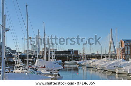 some boats anchoring in Boston (Massachusetts, USA) at winter time - stock photo