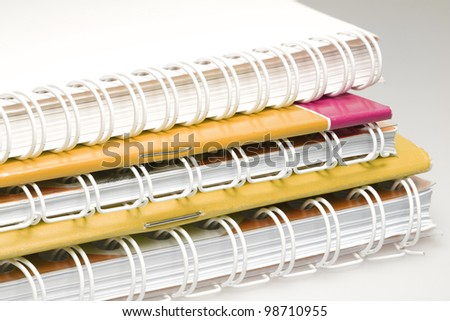 Some books and magazines on one another. - stock photo