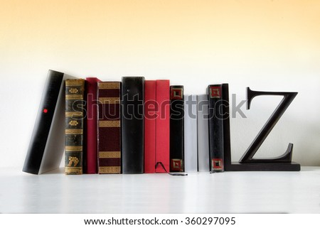 some books on a yellow background - stock photo