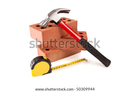 some brick , hammer And meter on isolated white - stock photo