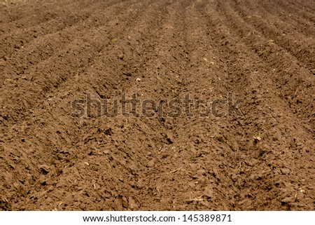 some brown soil waiting for farmers to plant plants