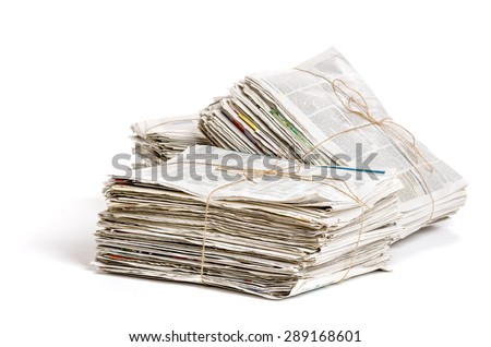 Some bundles of newspapers on a white background - stock photo