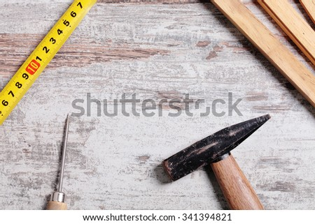 Some carpentry tools on a wooden table - stock photo