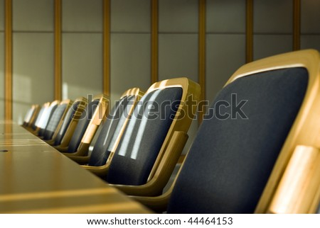 some chairs in conference room