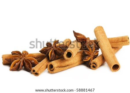 some cinnamon sticks and star anise on white background - stock photo