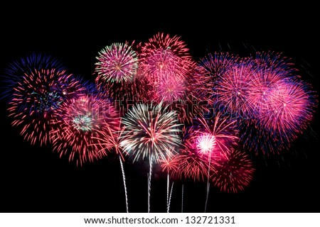 Some colorful fireworks in the night sky - stock photo