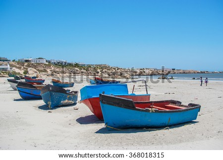 Some colorful fishing boats on the beach at Paternoster