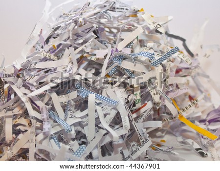 some confidential paperwork, shredded to avoid identity theft - stock photo