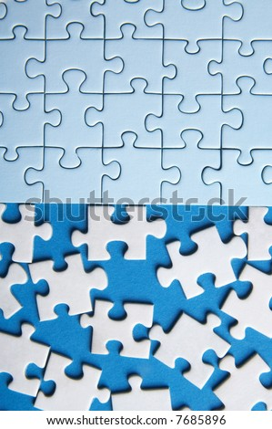 some connected puzzle pieces and some lost pieces on blue background