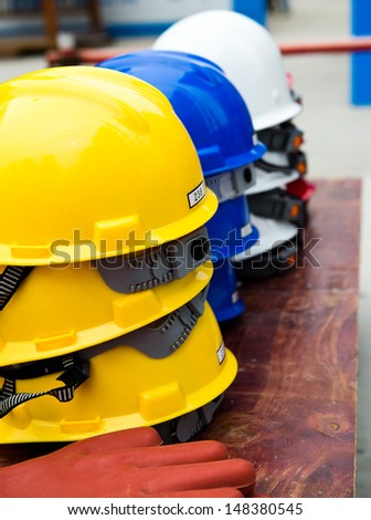 Some construction helmets on work place. - stock photo