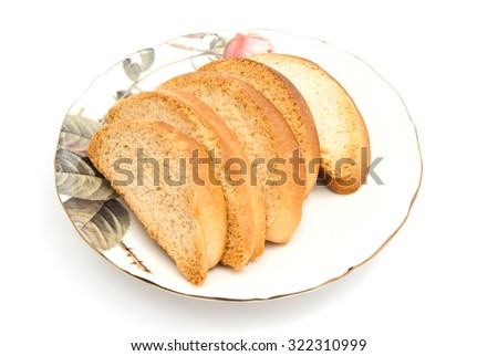 some crackers on glass plate on white - stock photo