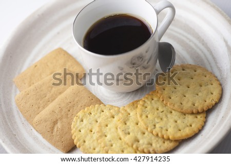 Some crackers with high content of dietary fiber,  a coffee cup on the plate. - stock photo