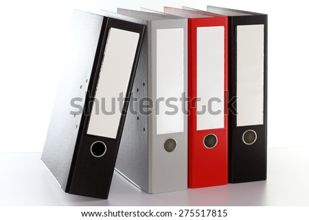 some different file folders in a row - stock photo
