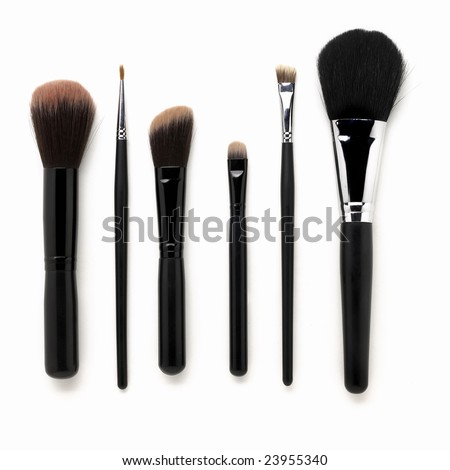 Some different kind of make-up brushes isolated on white - stock photo