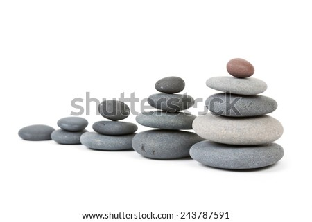 Some different pile of stones in row isolated - stock photo