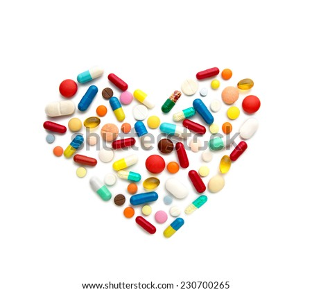 Some different pills in a heart form - stock photo