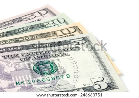 Some dollar bills on a white background