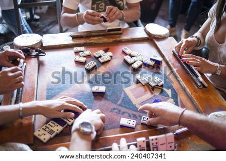 some domino players on the old table  - stock photo