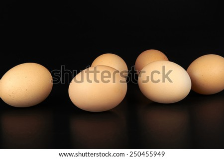 some eggs on black background