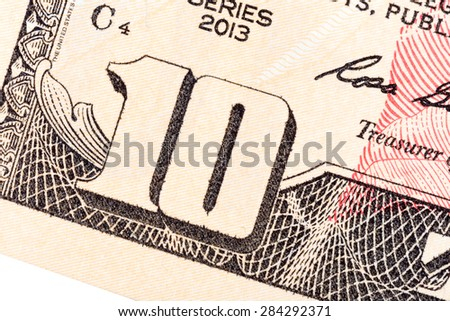 Some elements of ten U.S. dollar bill. - stock photo