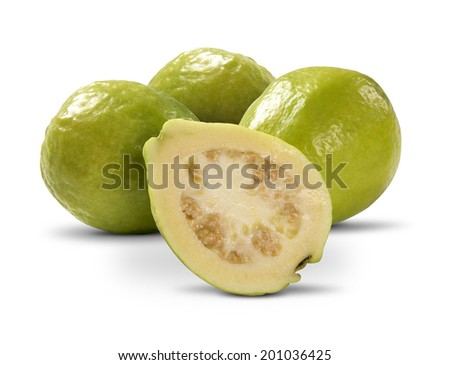 Some entire white guavas and a half on a white background - stock photo