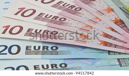 some euro bank notes fanned out on display - stock photo