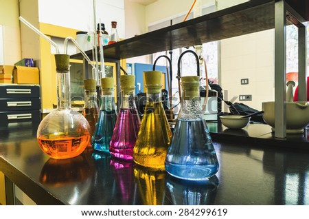 Some flasks in the chemical laboratory. Investigation and experiment concepts. - stock photo