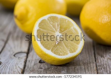 Some fresh Lemon Fruits on wood - stock photo