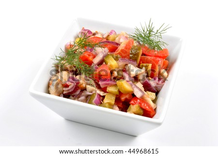 some fresh organic herring salad  in a bowl