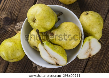 Some fresh Pears (selective focus) on wooden background - stock photo
