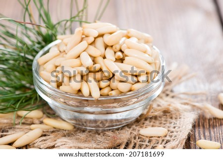 Some fresh Pine Nuts on dark vintage wooden background - stock photo