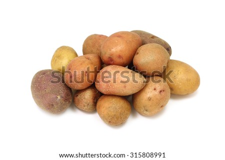 some fresh potatoes on a white background