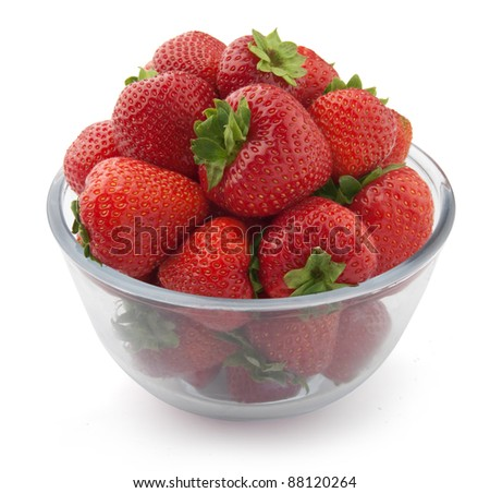 Some fresh red strawberries in the glass bowl - stock photo