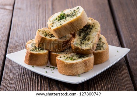 Some Garlic Bread pieces on wooden background - stock photo