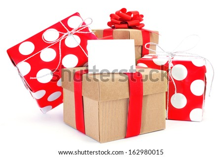some gifts with ribbons of different colors and a blank signboard with a copy-space on a white background  - stock photo