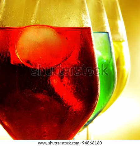 some glasses with cocktails of different colors - stock photo