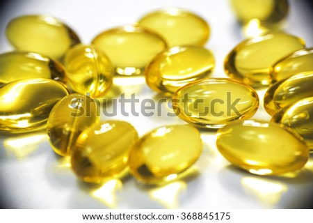Some gold colored omega3 soft gel capsules.