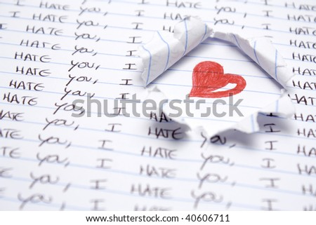Some hand writting saying i hate you. Red heart hand drawing - stock photo