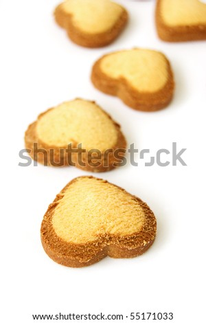 Some heart shaped biscuits over white - stock photo