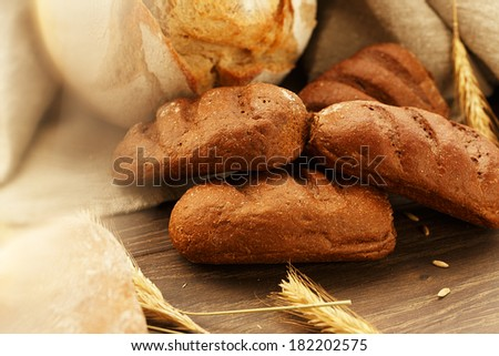 Some homemade bread on a wooden table - stock photo