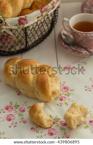some homemade brioche with tea on a white table