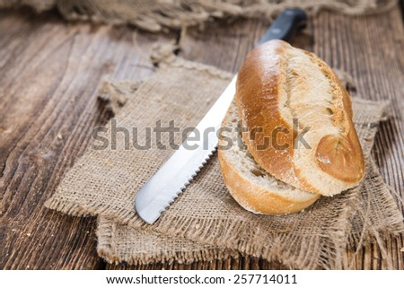 Some homemade Buns (close-up shot) on rustic wooden background - stock photo