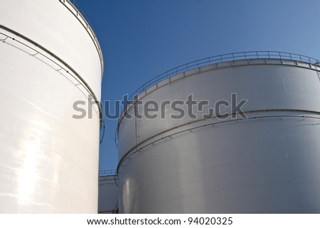 Some huge storage tanks of an oil refinery - stock photo