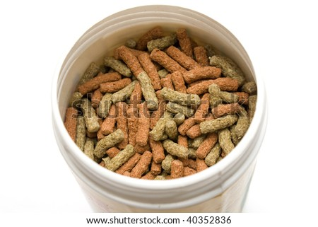 Some isolated pet food with white background - stock photo
