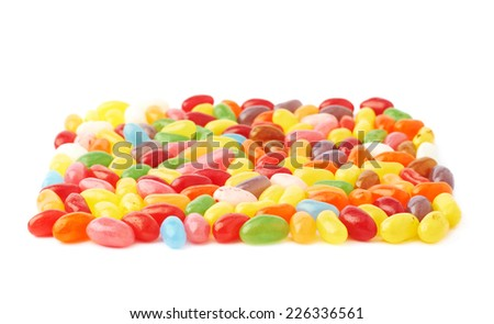 Some jelly bean sweets forming a square shape, isolated over the white background, shallow depth of field side view foreshortening - stock photo