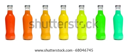 some juice bottles of different colors on a white background - stock photo